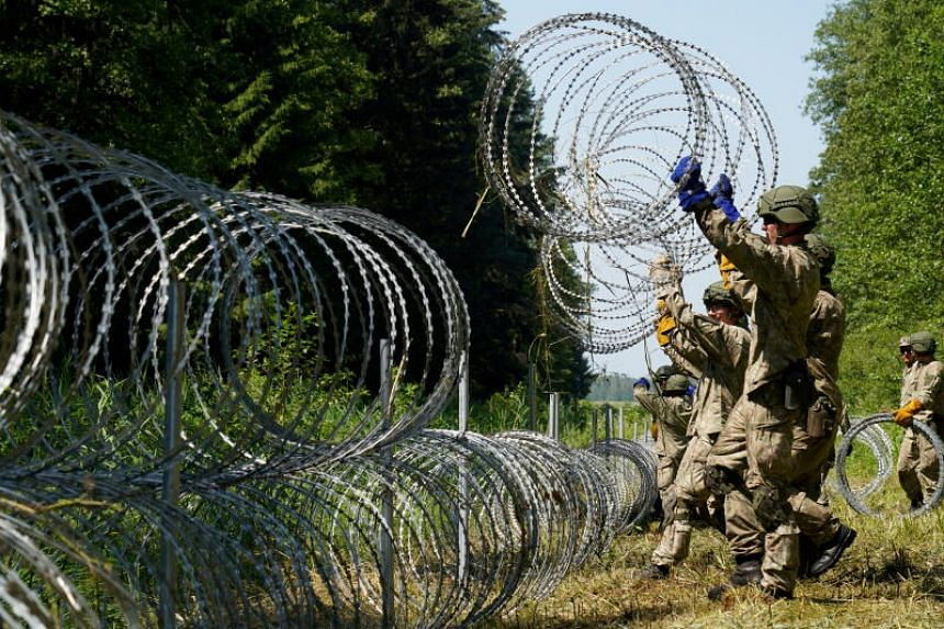 In July, Lithuania's military started to put up barbed wire on the Belarus border to deter asylum-seekers.