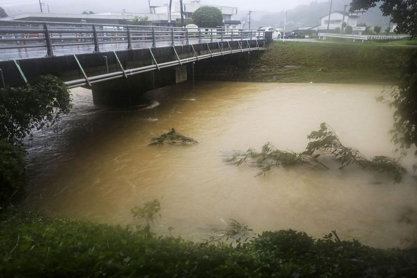 A swollen river caused by heavy rain in Nagomi town, Kumamoto prefecture, on Aug 12, 2021.