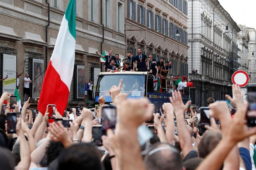 The Italy team driving through Rome on an open-top bus amid celebrating fans on July 12, 2021 after winning Euro 2020.