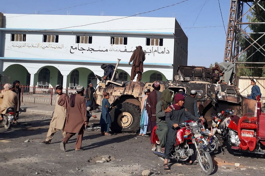Taleban militants gather after taking control of Lashkar Gah, the provincial capital of Helmand province in Afghanistan, on Aug 13, 2021.