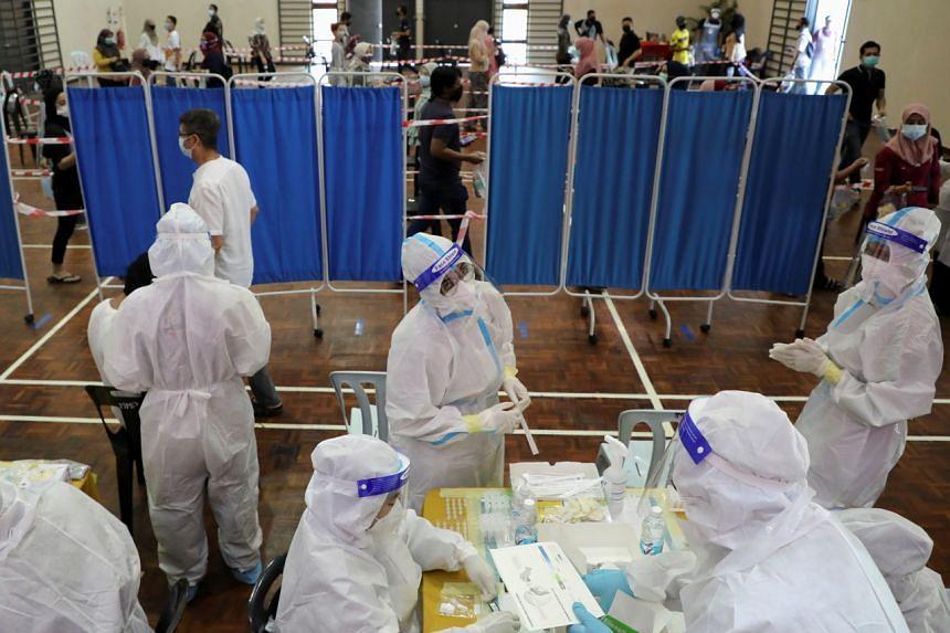 Medical personnel at a coronavirus disease testing centre in Cyberjaya, Malaysia, on June 2, 2021.