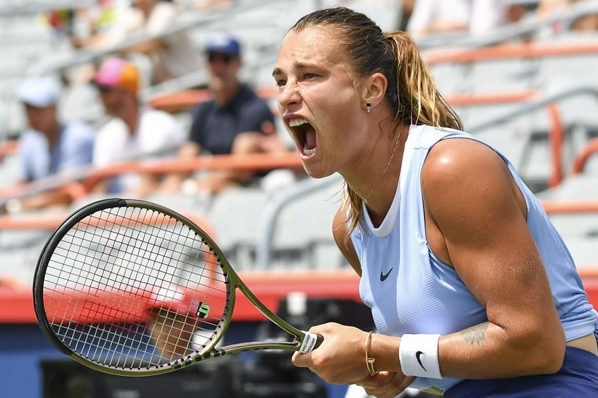 Aryna Sabalenka reacts after winning a point during her match against Victoria Azarenka.
