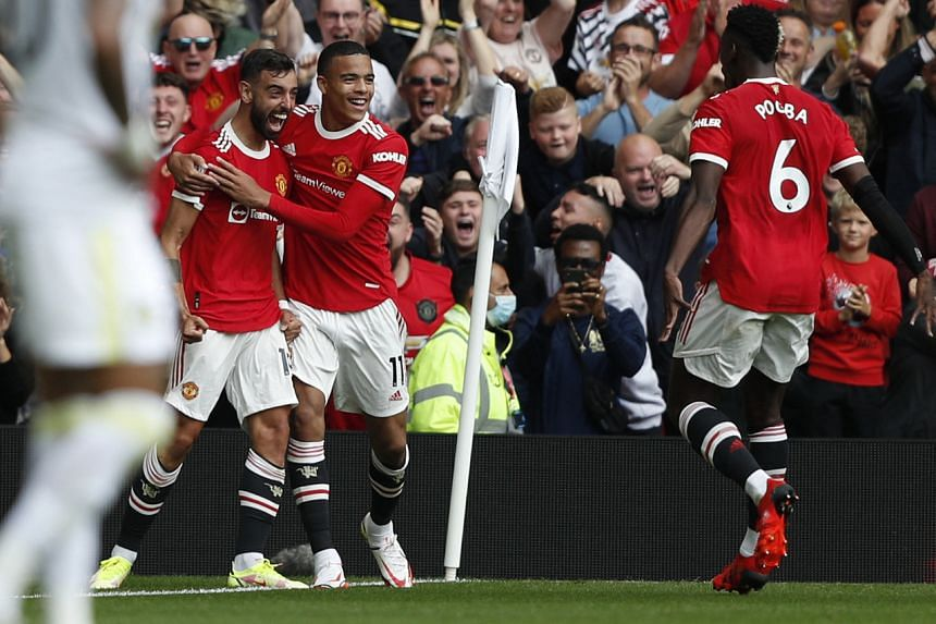 Bruno Fernandes (left) celebrates with Mason Greenwood after scoring the first goal.