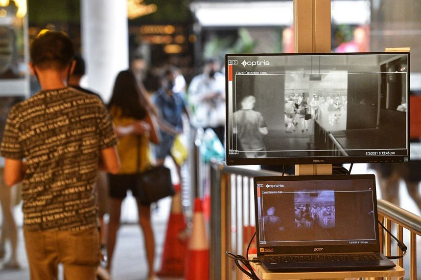 A temperature detection device screens shoppers during safe entry measures in PLQ Mall in February 2021.