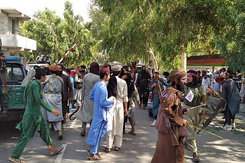 Taleban fighters seen along a street in Jalalabad province before they advance towards Kabul on Aug 15, 2021.