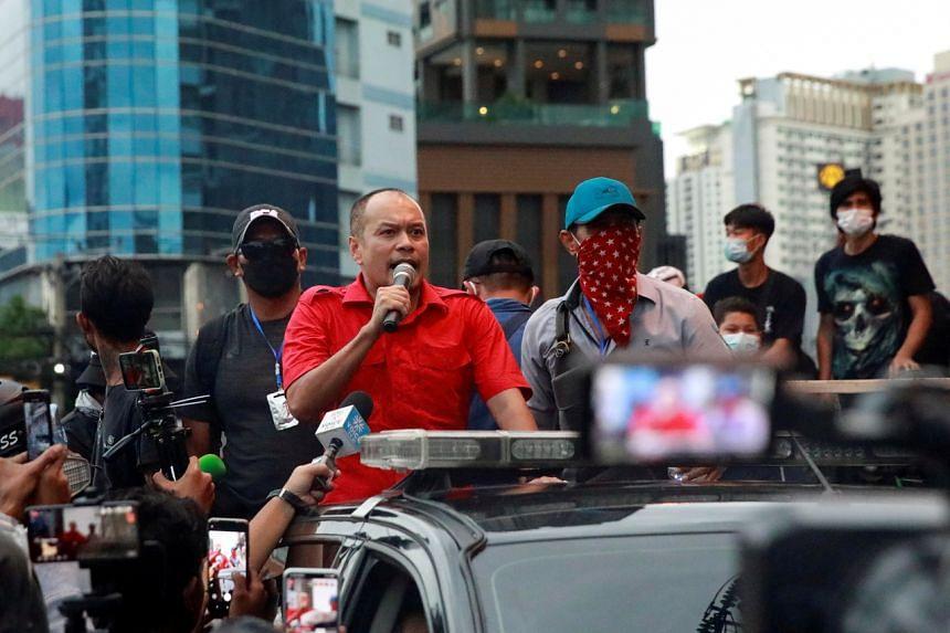 Veteran political activist Nattawut Saikua speaks as he urges demonstrators to head home during a protest in Bangkok, on Aug 15, 2021.