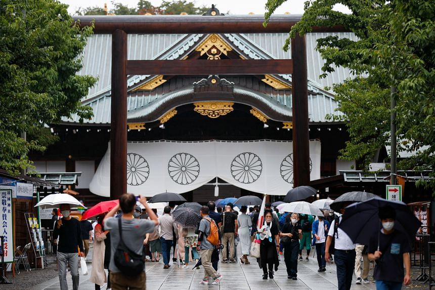 People visiting Yasukuni Shrine in Tokyo, Japan, on Aug 15, 2021. It honours the war dead, including World War II criminals.