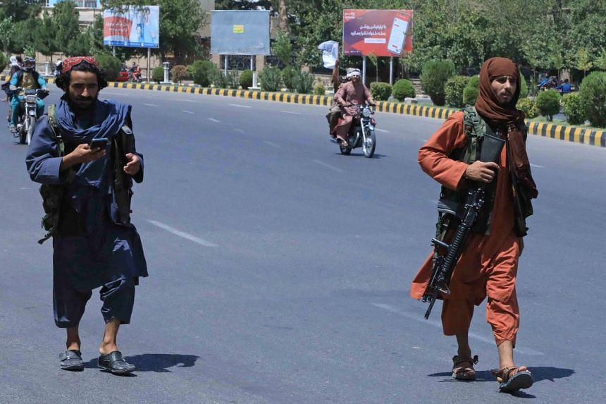 Taleban fighters patrol the streets of Herat on Aug 14, 2021.