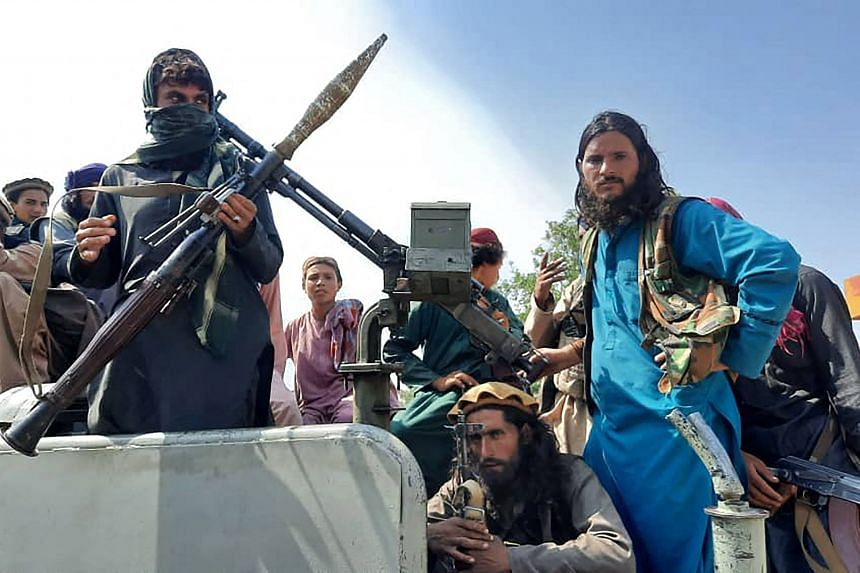 Taleban fighters on a street in Laghman province, Afghanistan, on Aug 15, 2021.