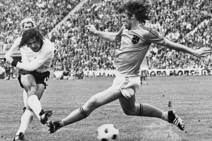 In a file photo taken on July 7, 1974, then West German forward Gerd Muller (left) scores the second goal for his team.