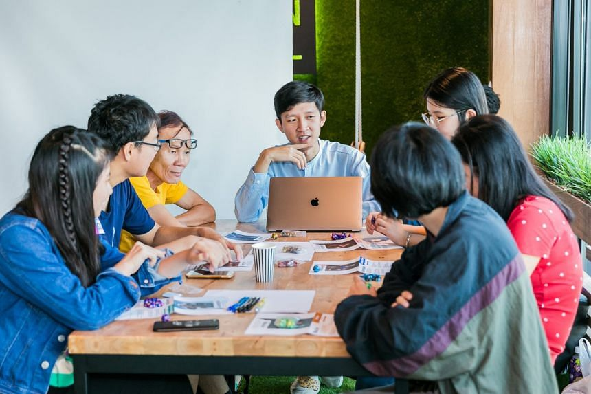Mr Louis Puah (centre) facilitating a role-playing game on issues related to at-risk youth in Singapore in 2019.