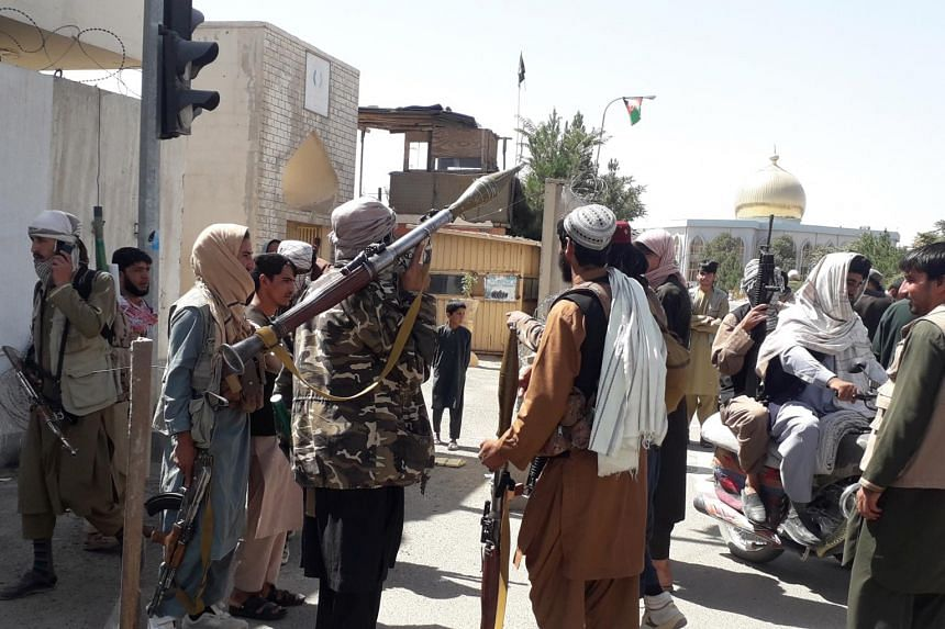 Taleban militants patrol after taking control of the Governor's house and Ghazni city on Aug 12, 2021.