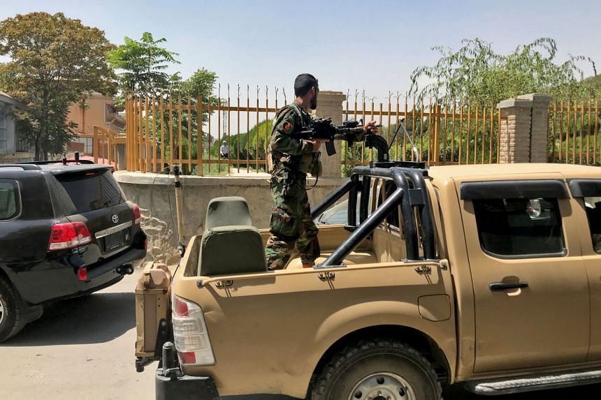 An Afghan soldier stands in a military vehicle on a street in Kabul on Aug 15, 2021.