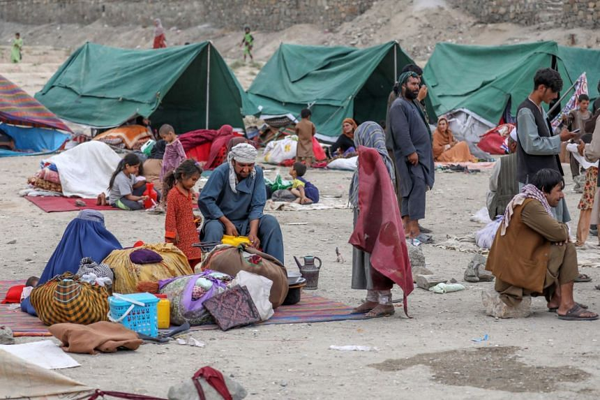 Internally displaced families from northern Afghan provinces taking shelter in a public park in Kabul, on Aug 14, 2021.