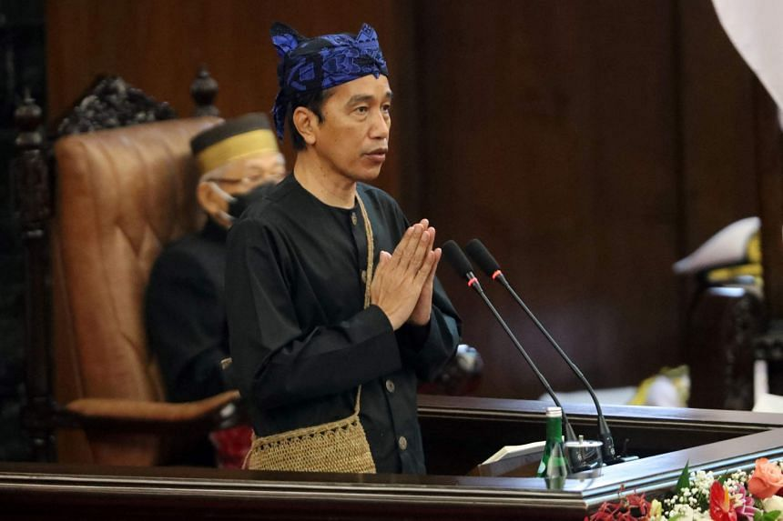 President Joko Widodo, dressed in a Baduy tribe traditional costume, delivering his 2022 state budget address on Aug 16, 2021.