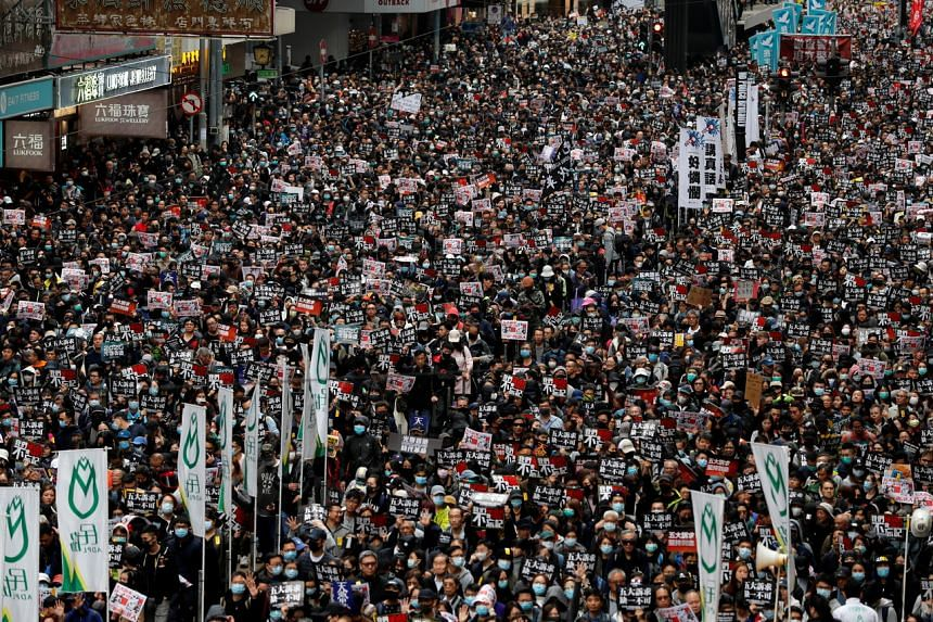 Anti-government protesters attend a demonstration held by Civil Human Rights Front in Hong Kong, on Jan 1, 2020.