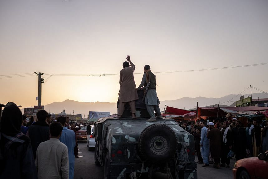 Taleban fighters on a Humvee in Kabul, Afghanistan, on Aug 15, 2021.