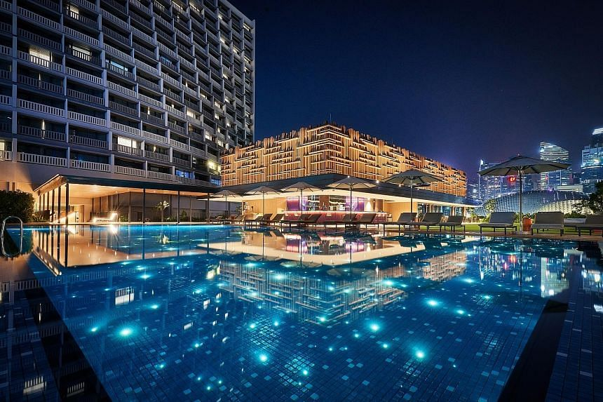 (From above) Parkroyal Collection Marina Bay's illuminated pool, the hotel's atrium and the rooftop farm.