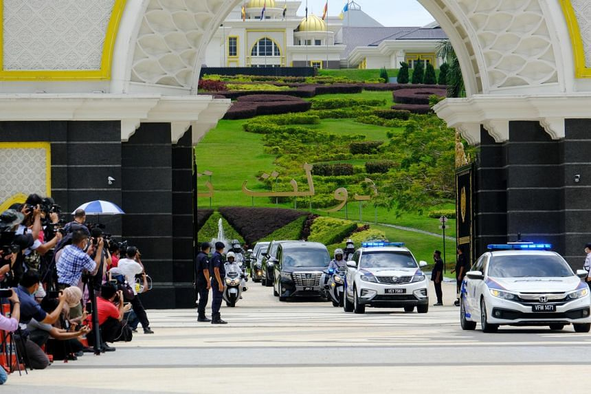 Malaysia's Prime Minister Muhyiddin Yassin departs the Istana Negara palace in Kuala Lumpur on  Aug. 16, 2021.
