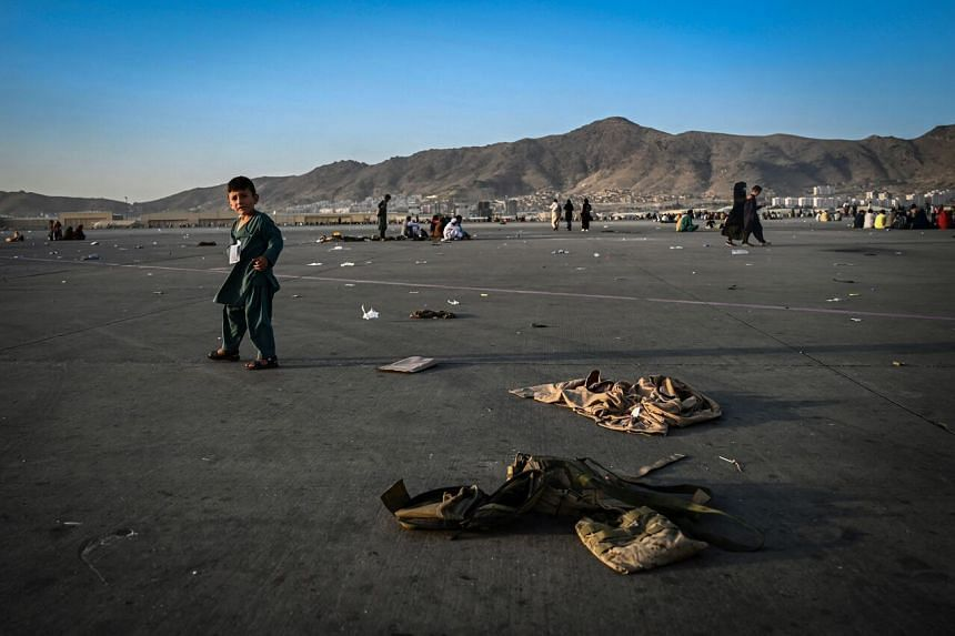 An Afghan child at Kabul airport on Aug 16, 2021.