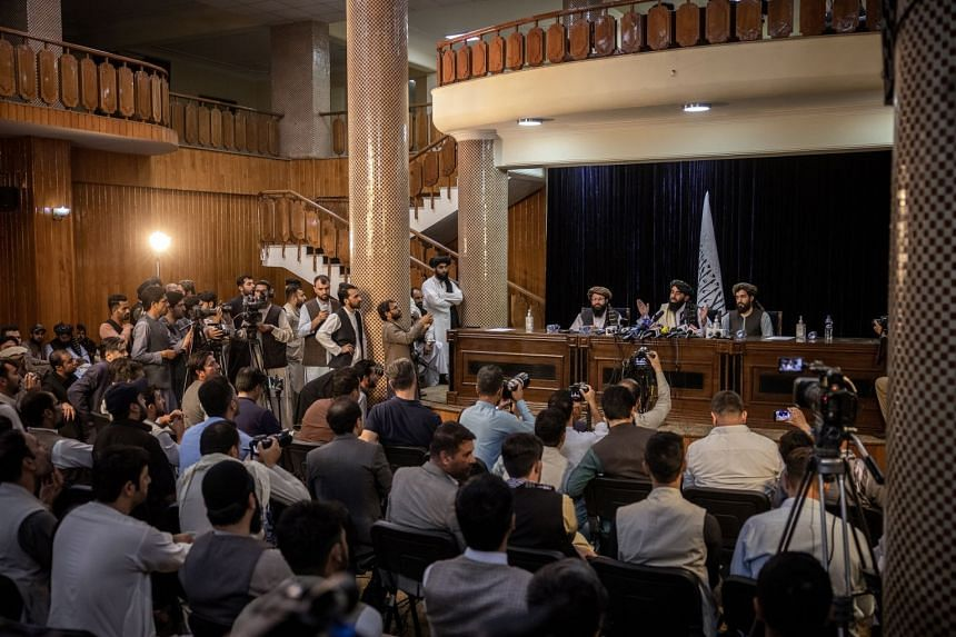 Taleban spokesman Zabihullah Mujahid addresses reporters in Kabul on Aug 17, 2021, at the militant group's first news conference since it took control of Kabul.