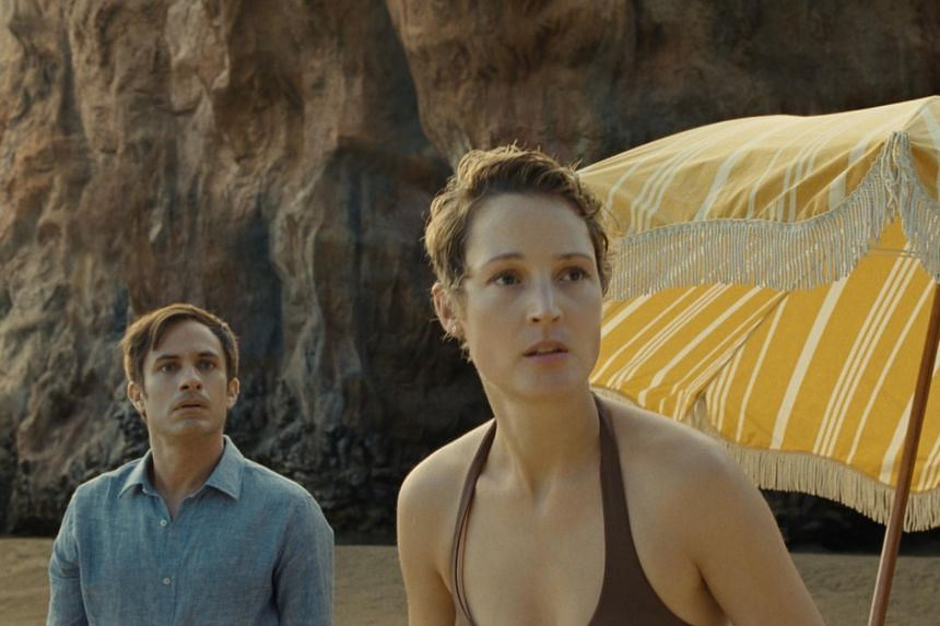 A movie still from the film Old starring Gael Garcia Bernal (left) and Vicky Krieps.
