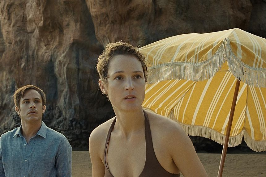 The Night House stars Rebecca Hall (above) as a bereaved widow, while Gael Garcia Bernal and Vicky Krieps (both left) play a couple holidaying at a beach in Old.