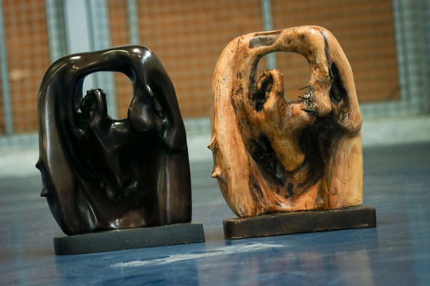 The titles for these two similar pieces are unknown. They are made of bronze (left) and bog wood (right). The bronze is priced at $7,000 to $10,000 while the wood is $5,000 to $8,000.
