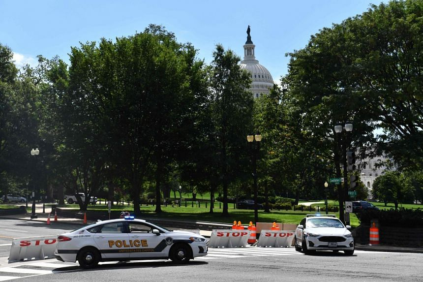 US Capitol police block a street during an investigation into a possible bomb threat near the US Capitol and Library of Congress in Washington.