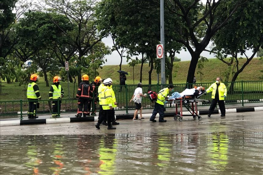 An injured person being taken away by the SCDF from the junction of Tampines Avenue 10 and Pasir Ris Drive 12.