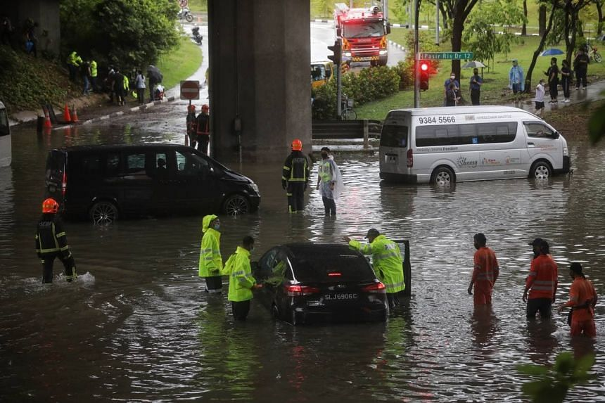 Car left stranded in flood waters at the junction of Pasir Ris Drive 12 and Tampines Avenue 10 on Aug 20, 2021.