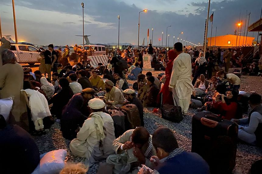 Afghans wait to board a US military aircraft to leave Afghanistan, at the military airport in Kabul on Aug 19, 2021.