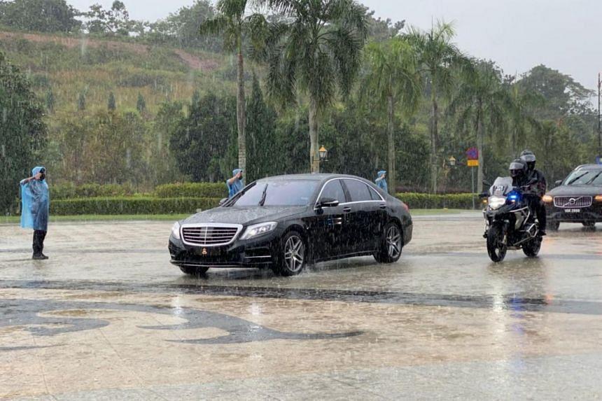 A motorcade bearing the Pahang royal emblem entering the gates of Istana Negara on Aug 20, 2021.