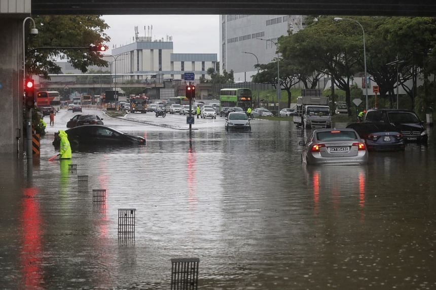 Cars left stranded in flood waters at the junction of Pasir Ris Drive 12 and Tampines Avenue 10 on Aug 20, 2021.