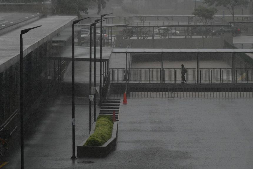 The National Environment Agency said widespread moderate to heavy rain fell over the island from 5am on Friday morning.