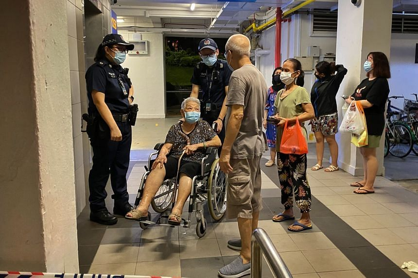 Residents of Block 117 Bukit Merah View gathered at the foot of the block on Aug 20, 2021.