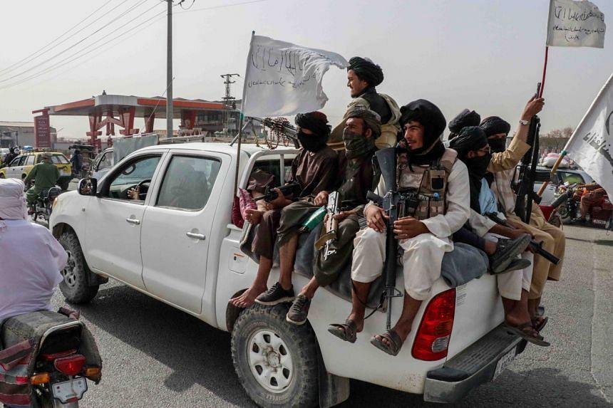 Taleban fighters patrol in Kandahar, Afghanistan, on Aug 17, 2021.