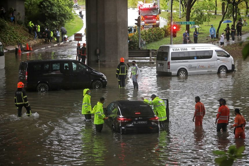 Cars left stranded in flood waters at the junction of Pasir Ris Drive 12 and Tampines Avenue 10, on Aug 20, 2021.