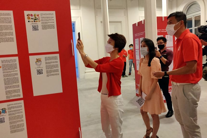 Minister of State for Culture, Community and Youth Low Yen Ling (left) and Brigadier-General Tan Cheng Kwee (right) at the opening of the interactive exhibition at the National Museum of Singapore on Aug 20, 2021.