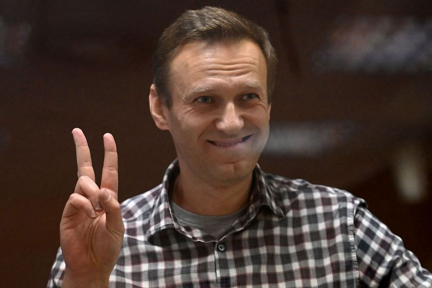 Navalny gestures from inside a glass cell during a court hearing in Moscow in February 2021.