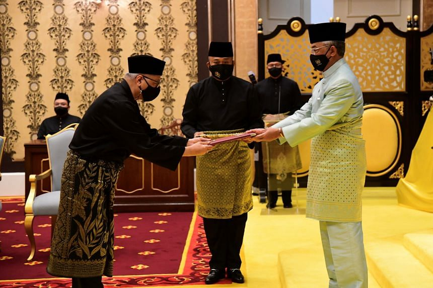 Malaysia's King Sultan Abdullah Ahmad Shah (right) presided over Datuk Seri Ismail Sabri Yaakob's oath-taking.