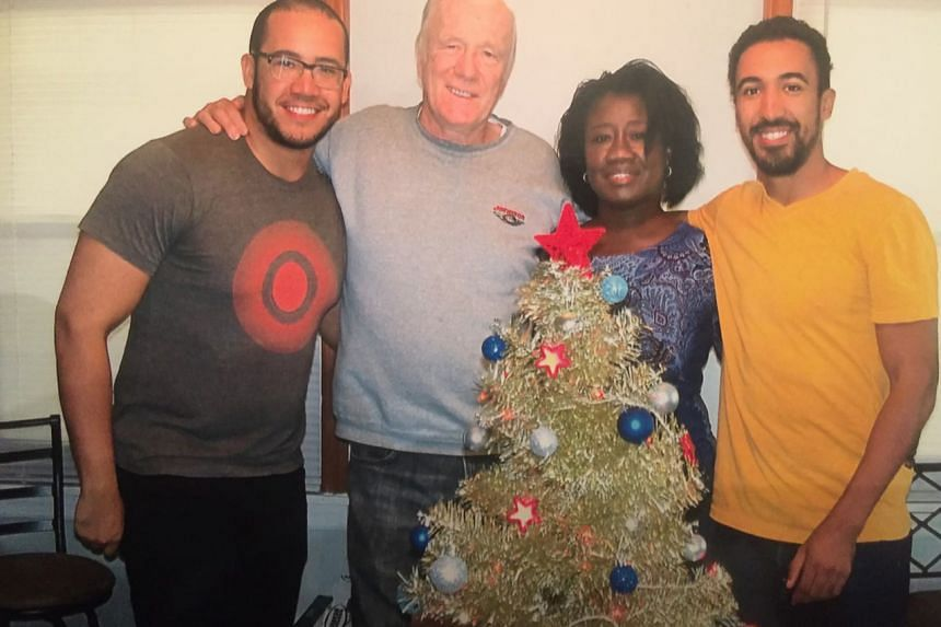 Mr Justin Harriot (far right), with his father Bill, mother Carmen and younger brother Holden.