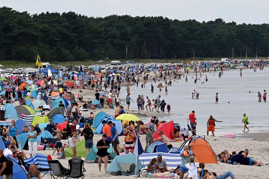 Tourists on the beach of Binz, on the German island of Ruegen, on Aug 9, 2021.