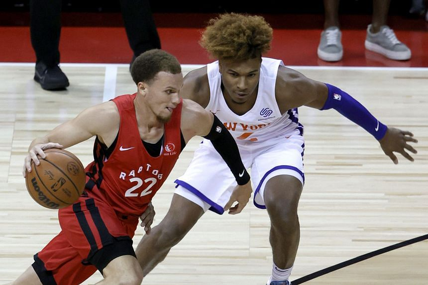 The Raptors' Malachi Flynn (left) drives against the Knicks' Miles McBride during a game in Las Vegas on Aug 8, 2021.
