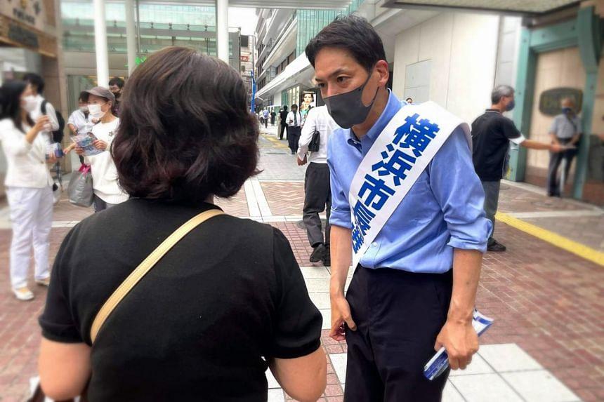 Dr Takeharu Yamanaka campaigning in Yokohama last month, ahead of its mayoral election on Aug 22.