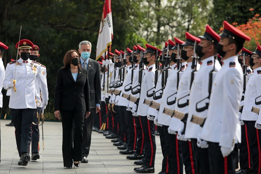 US Vice-President Kamala Harris and Prime Minister Lee Hsien Loong inspecting the guard of honour before entering the Istana building.