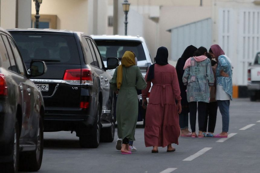 Afghan women are seen in a villa complex near Doha, on Aug 21, 2021.