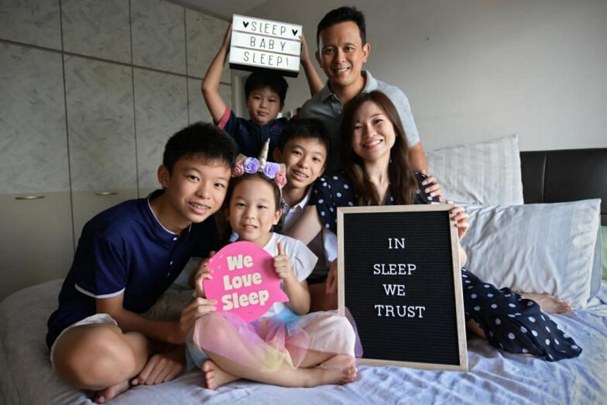 Ms Zoe Chu tries to get her children to sleep earlier but often can't because of their school work and tuition.