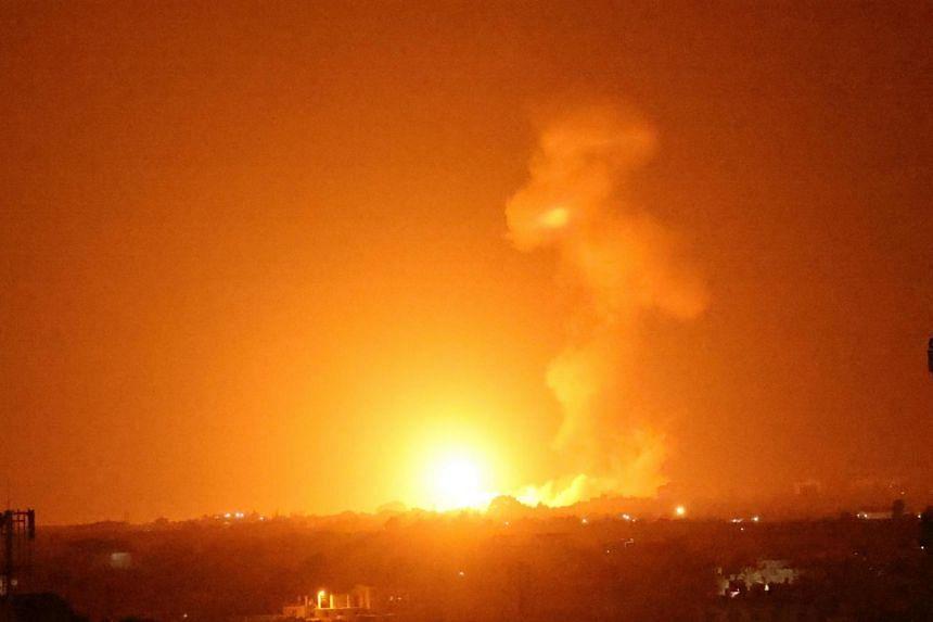 A fireball rises following an air strike in Khan Yunis in the southern Gaza Strip on Aug 23, 2021.