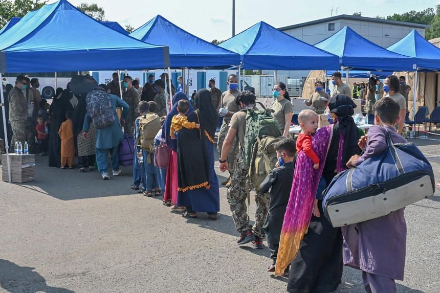 Afghan evacuees lining up to be processed at Ramstein Air Base in Germany on Aug 21, 2021.